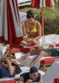 Dua Lipa spotted in a yellow bikini as she lounges by the pool with boyfriend Isaac Carew and sister Rina in Miami, Florida