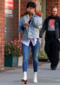 Eiza Gonzalez covers her face as she leaves a dermatologist appointment in Beverly Hills, Los Angeles