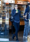 Elizabeth Olsen looks cute in a blue top paired with matching leggings as she picks up a healthy juice while out in Los Angeles