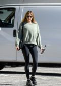 Elizabeth Olsen sports a green sweatshirt and black leggings as she leaves the gym in Los Angeles