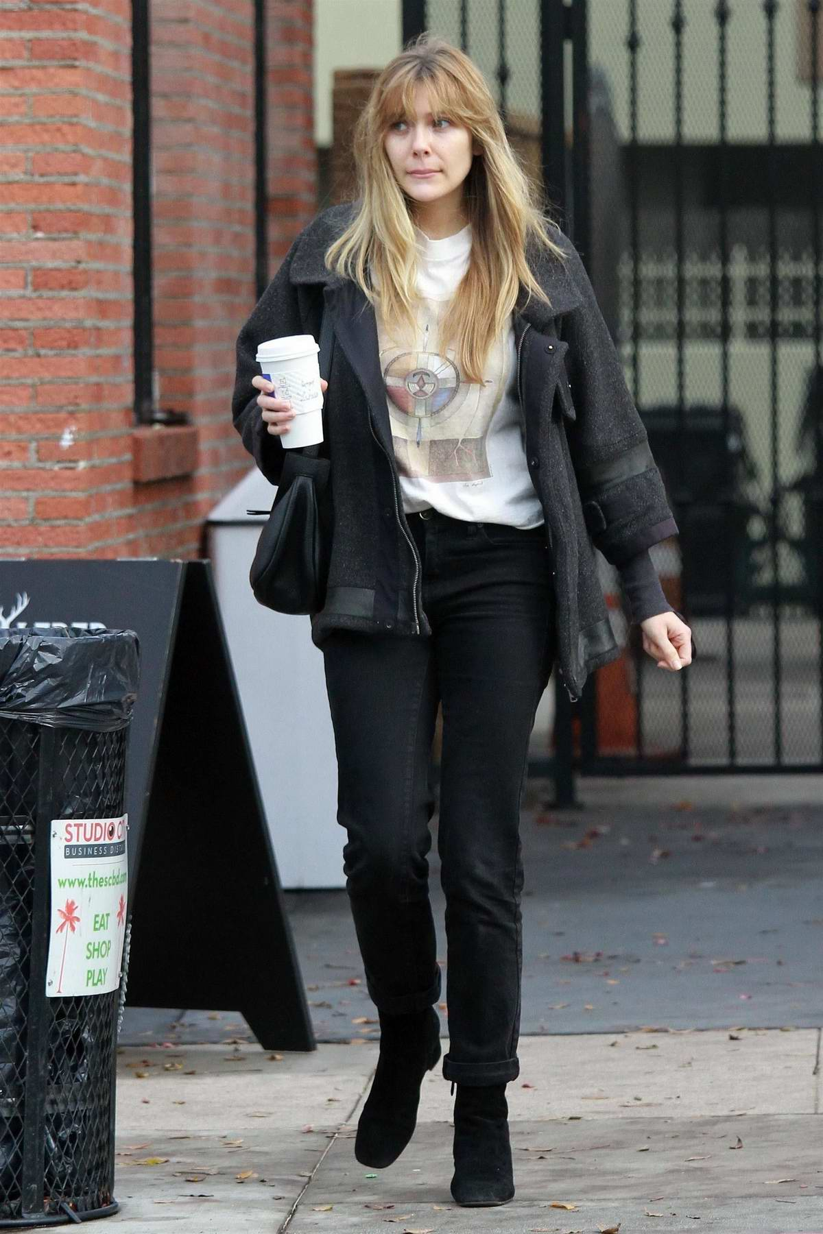 Elizabeth Olsen wore a dark grey jacket, white tee and black jeans during a coffee run at Alfred's in Studio City, Los Angeles