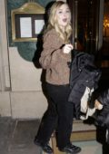Elle Fanning looks cute in a sweater as she arrives at her hotel during the Paris Fashion Week in Paris, France