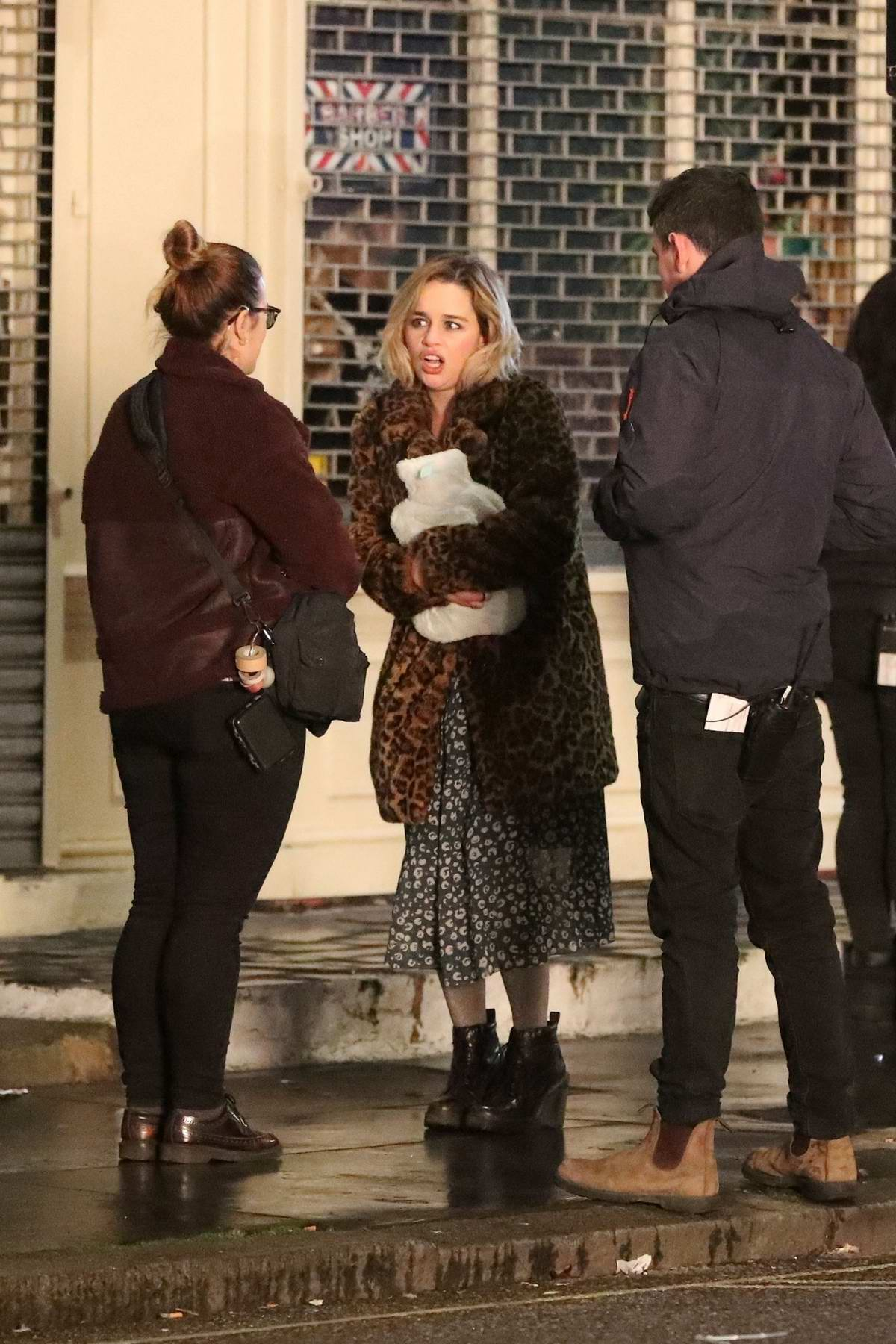 Emilia Clarke spotted in a leopard print fur coat while filming 'Last Christmas' outside a pub in North London, UK