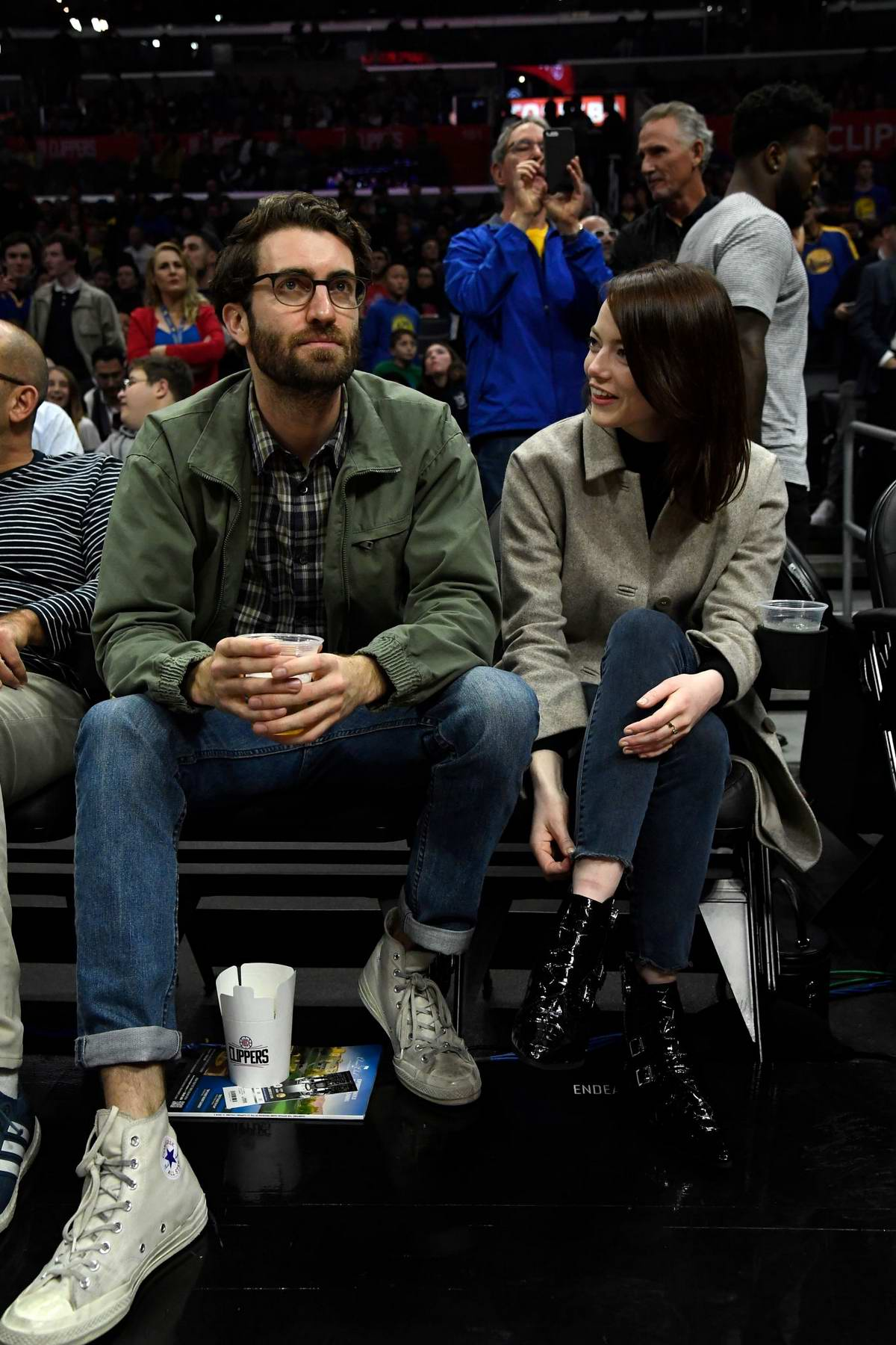 Emma Stone and Dave McCary attends the Golden State Warriors v Los Angeles Clippers basketball game at Staples Center in Los Angeles