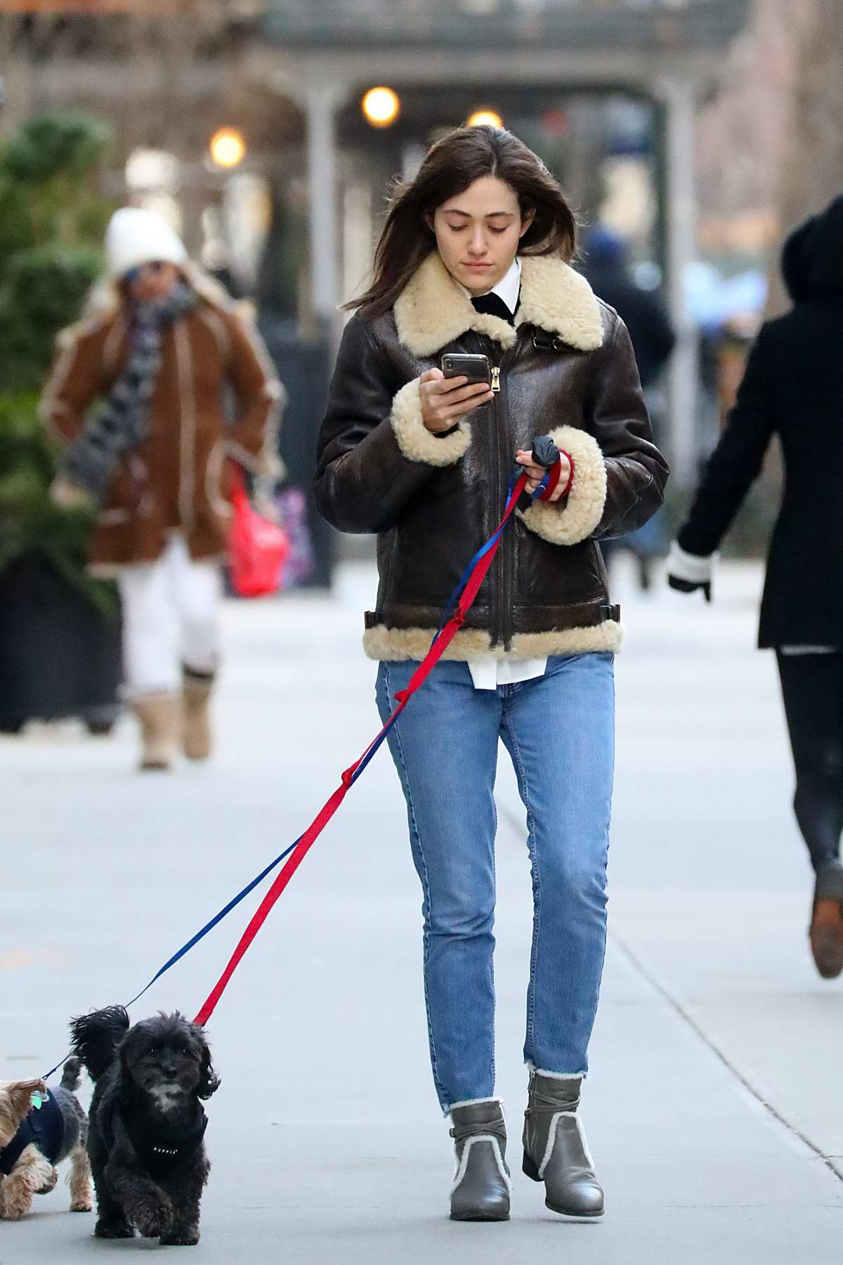 Emmy Rossum steps out to walk her dogs in New York City