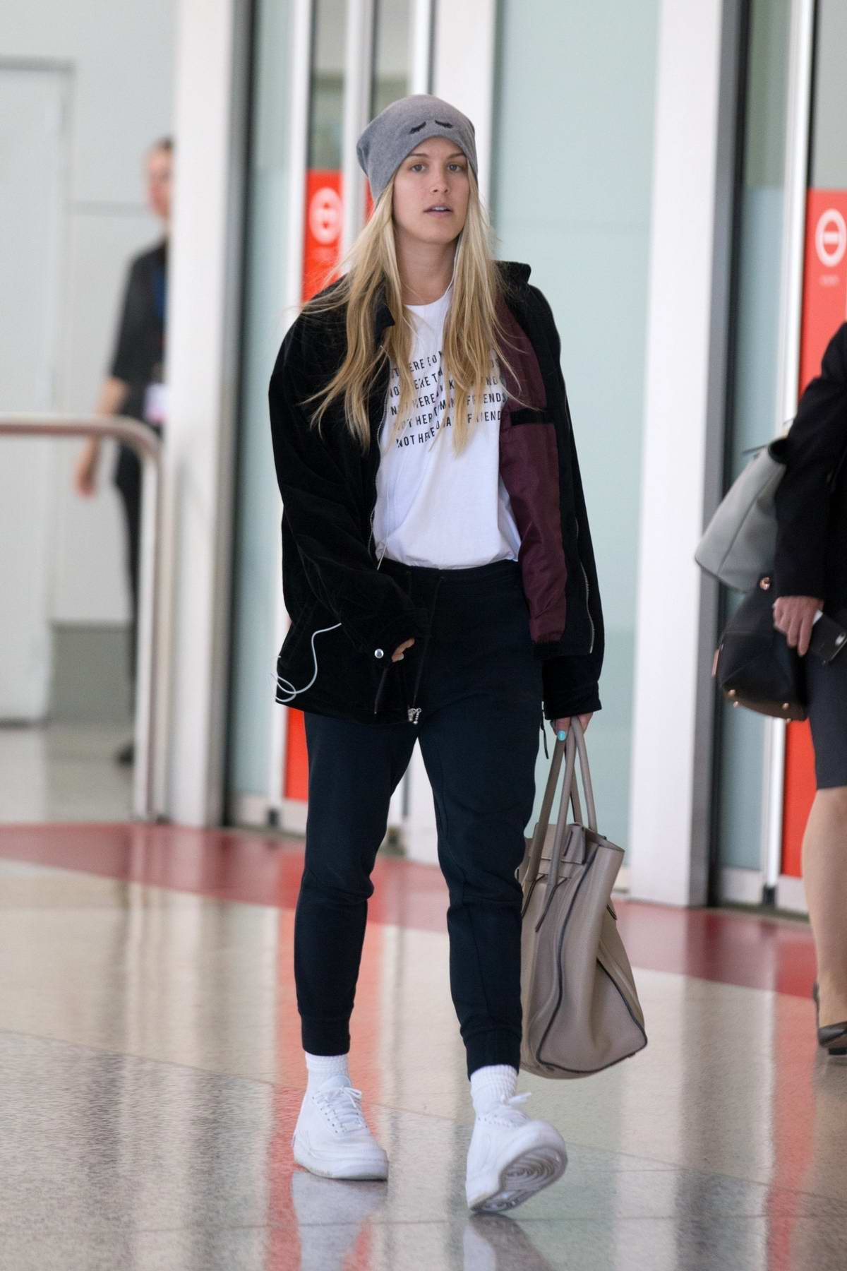 Eugenie Bouchard keeps it casual as she arrives into Melbourne airport, Australia