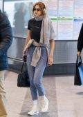 Gigi Hadid keeps it casual yet trendy at the airport as she departs after MFW in Milan, Italy