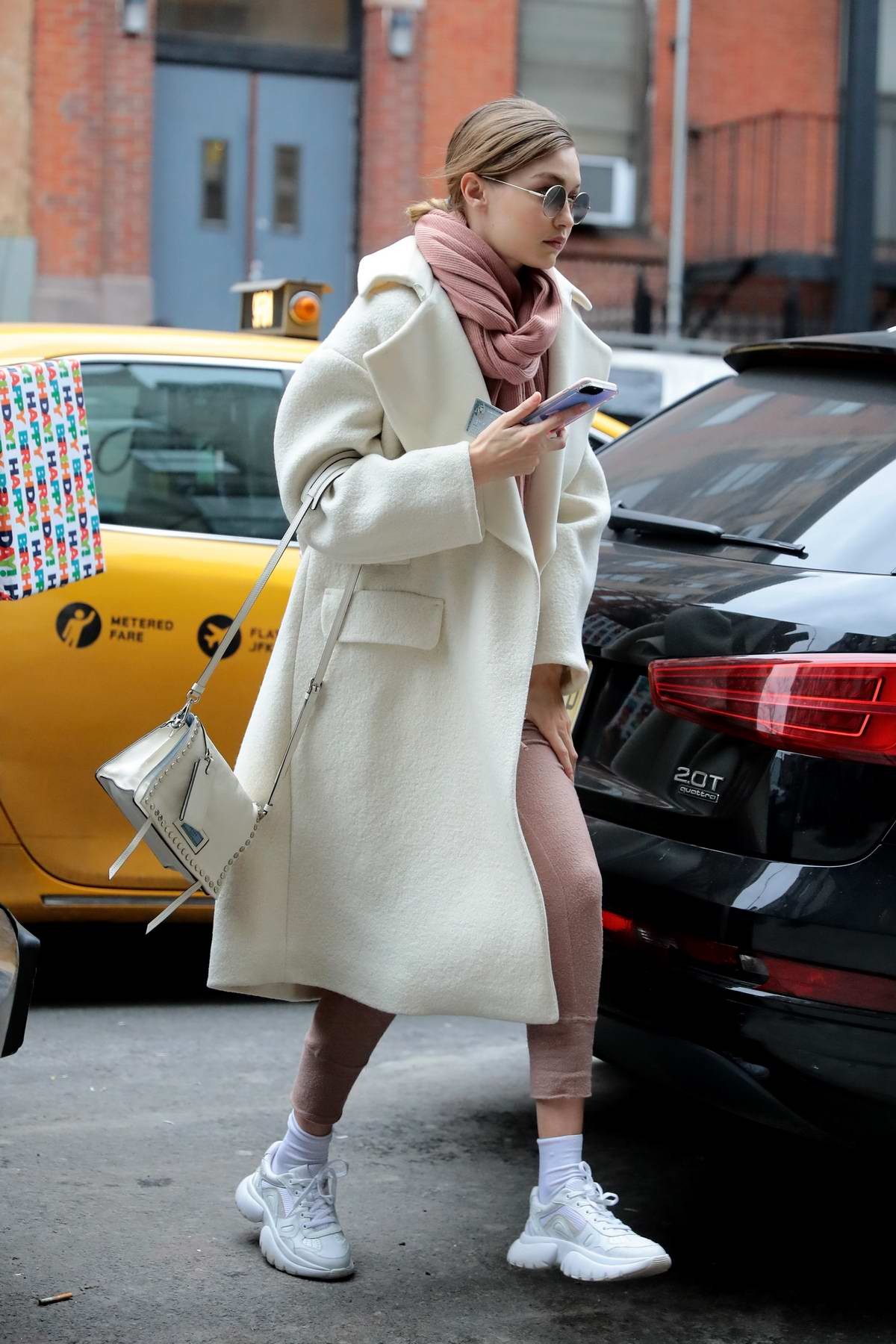 Gigi Hadid keeps warm in a stylish coat while out in New York City