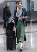 Gigi Hadid rocks her Beats headphones as she arrives at Malpensa Airport in Milan, Italy