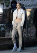 Gigi Hadid seen wearing a white cropped jacket and drawstring pants during a photoshoot on a chilly day in New York City