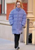 Gigi Hadid steps out for a stroll wearing a pinstripe puffer jacket while listening to her Beats earphones in New York City