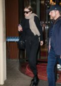 Gigi Hadid wears all black while leaving her hotel in Paris, France