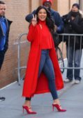 Gina Rodriguez dons a red coat with matching top and heels as she visits The View Show in New York City