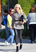 Gwen Stefani wore a plaid jacket and black leather pants as she heads to church in Los Angeles