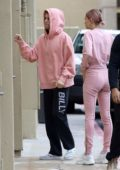 Hailey Baldwin Bieber and Justin Bieber wore matching pink outfits while stopping by West Valley Medical Center in Encino, California