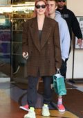 Hailey Baldwin Bieber is all smiles as she sports her new pink hair while out shopping with Justin Bieber at Barnes & Noble in Los Angeles