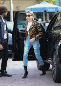 Hailey Baldwin Bieber looks trendy in a Louis Vuitton jacket while stopping by at Alfred Coffee in Brentwood, Los Angeles