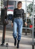 Hailey Baldwin Bieber rocked a Balenciaga top while stopping by at Joan's on Third in Los Angeles