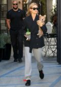 Hailey Baldwin Bieber steps out with her puppy as she stops by Alfred's to grab a smoothie in West Hollywood, Los Angeles