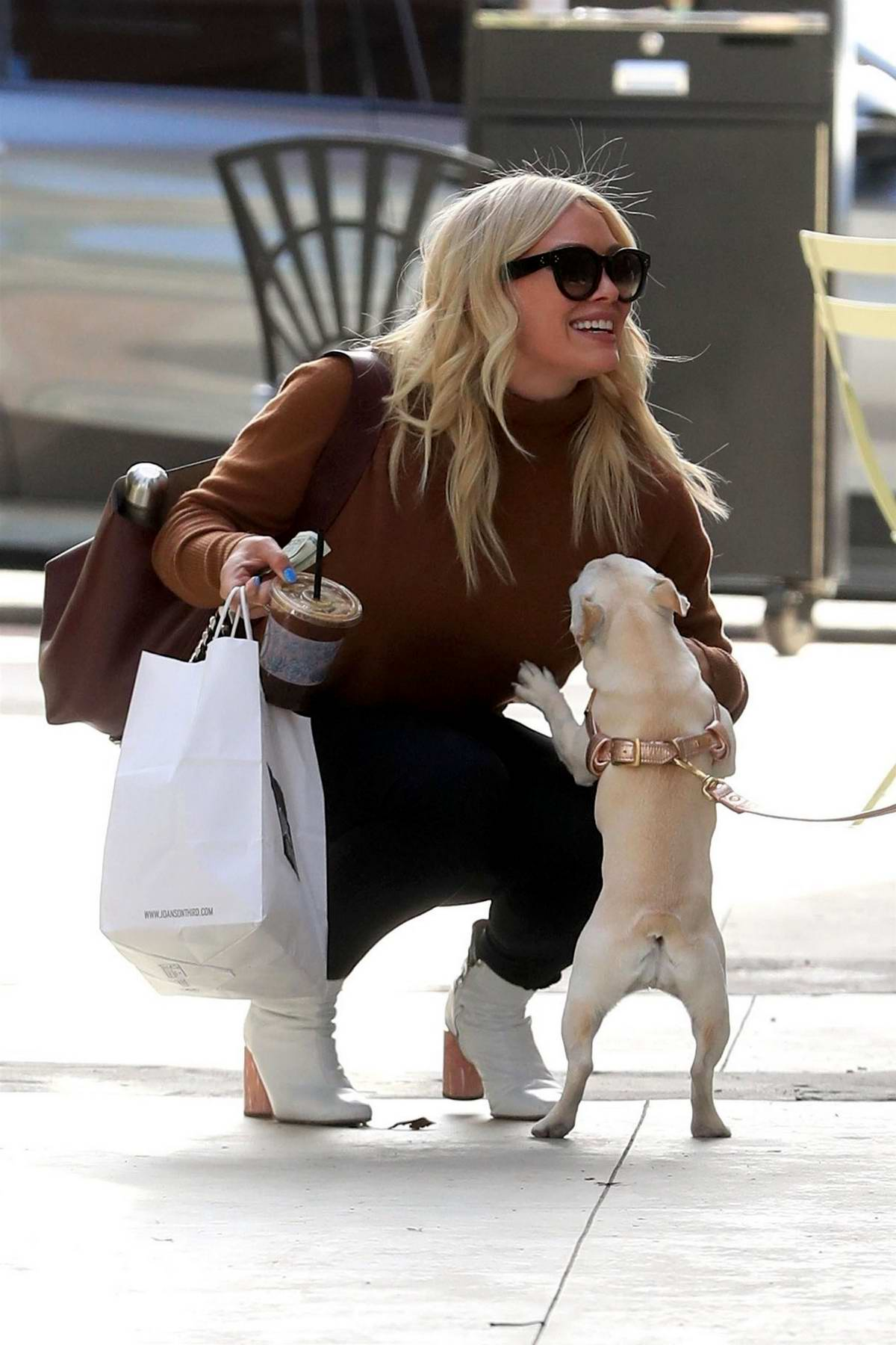 Hilary Duff stops to pet a dog while out to pick up lunch to-go at Joan's on Third in Studio City, Los Angeles