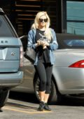 Holly Madison wears a graphic black tee, black leggings with a denim jacket while stopping by Gelson's in Los Feliz, California