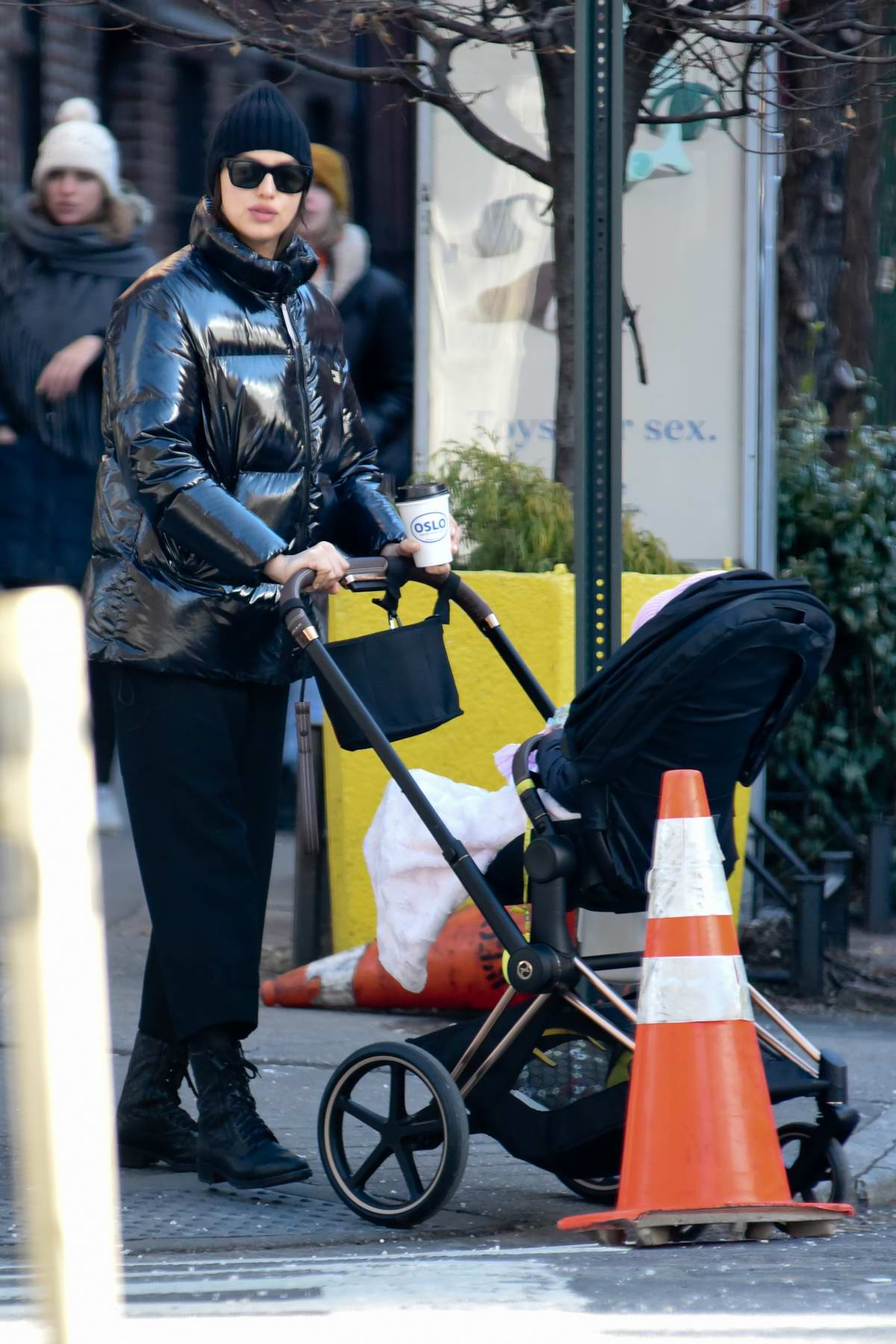 Irina Shayk bundles up in a black puffer jacket as she takes her daughter out for a stroll in New York City