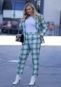 Iskra Lawrence seen wearing a plaid suit and white boots while out in Los Angeles