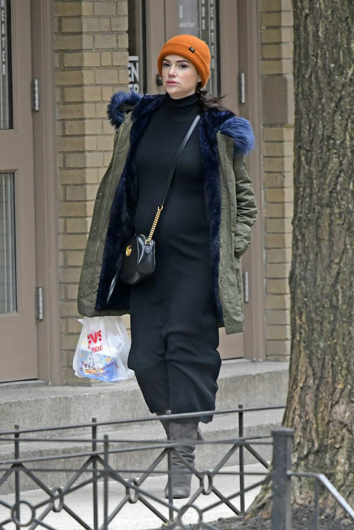Janet Montgomery shows off her baby bump while out shopping at CVS pharmacy in SoHo, New York City