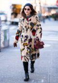 Jenna Coleman wears a sketched fur coat while out in the East Village in New York City