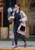Jenna Dewan wore a raincoat with a grey hoodie and splatter print bodysuit while out to pick up lunch at Kreation in Los Angeles