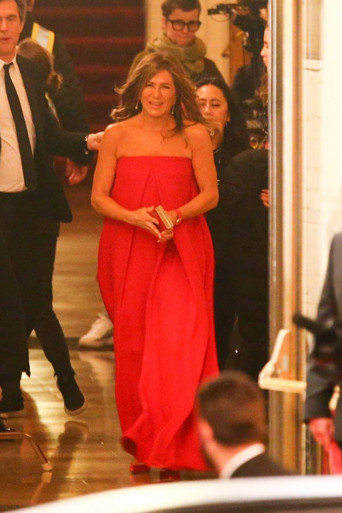 Jennifer Aniston seen wearing a red dress while filming on the set of her new TV show 'Top Of The Morning' in Los Angeles