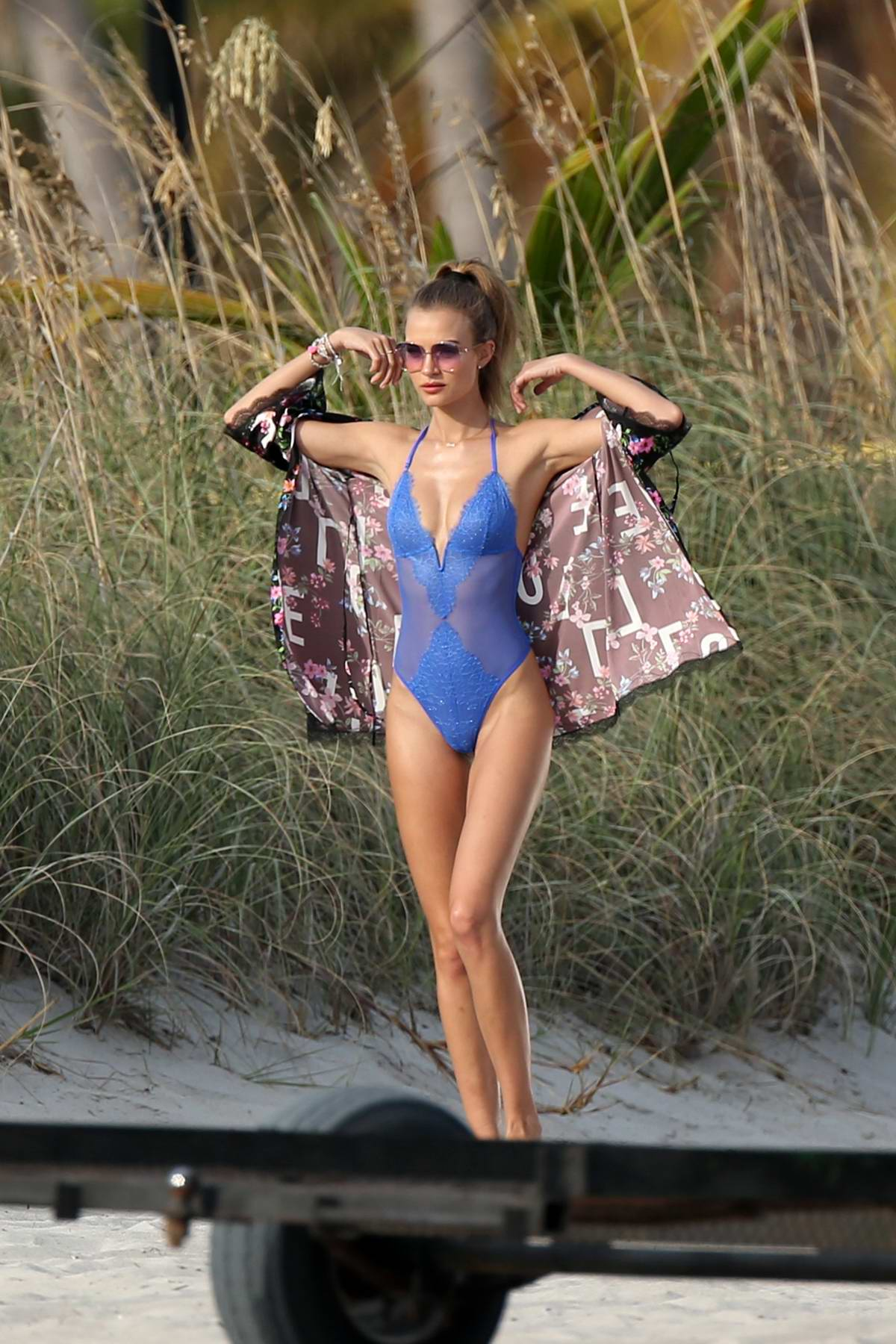 Josephine Skriver poses in a blue swimsuit as she during a Victoria's Secret photoshoot in Miami, Florida