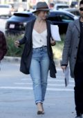 Julianne Hough steps out in white top and jeans with a grey fedora while looking for some retail space in West Hollywood, Los Angeles