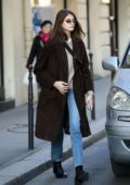 Kaia Gerber seen wearing brown coat, beige top and jeans as she leaves Chanel Cambon office in Paris, France
