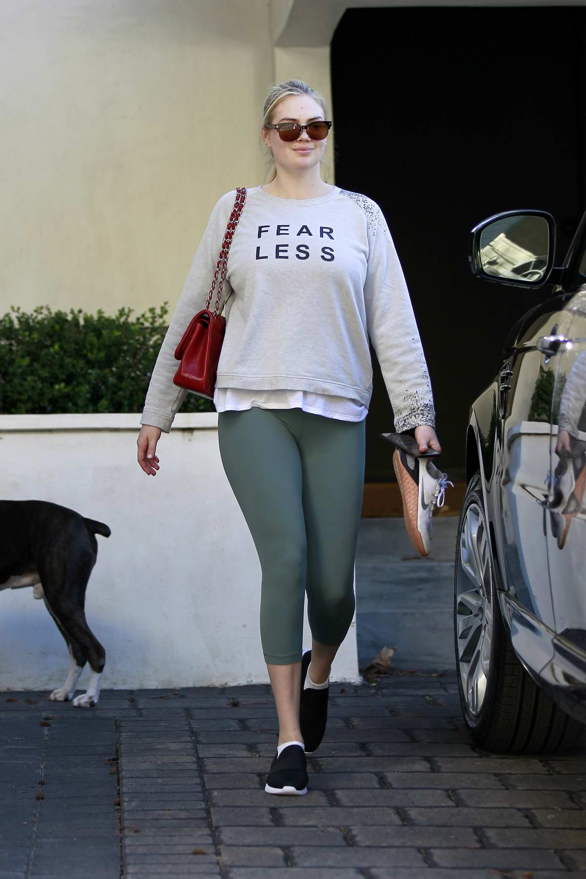 Kate Upton rocks 'FEARLESS' sweatshirt and green leggings as she leaves after her workout session in Los Angeles