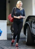 Kate Upton wears a black top and black leggings as she leave Ben Bruno's gym after her morning workout in Beverly Hills, Los Angeles