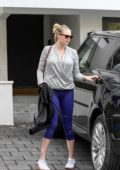 Kate Upton wore a grey sweatshirt and blue leggings while heading for a workout in Los Angeles
