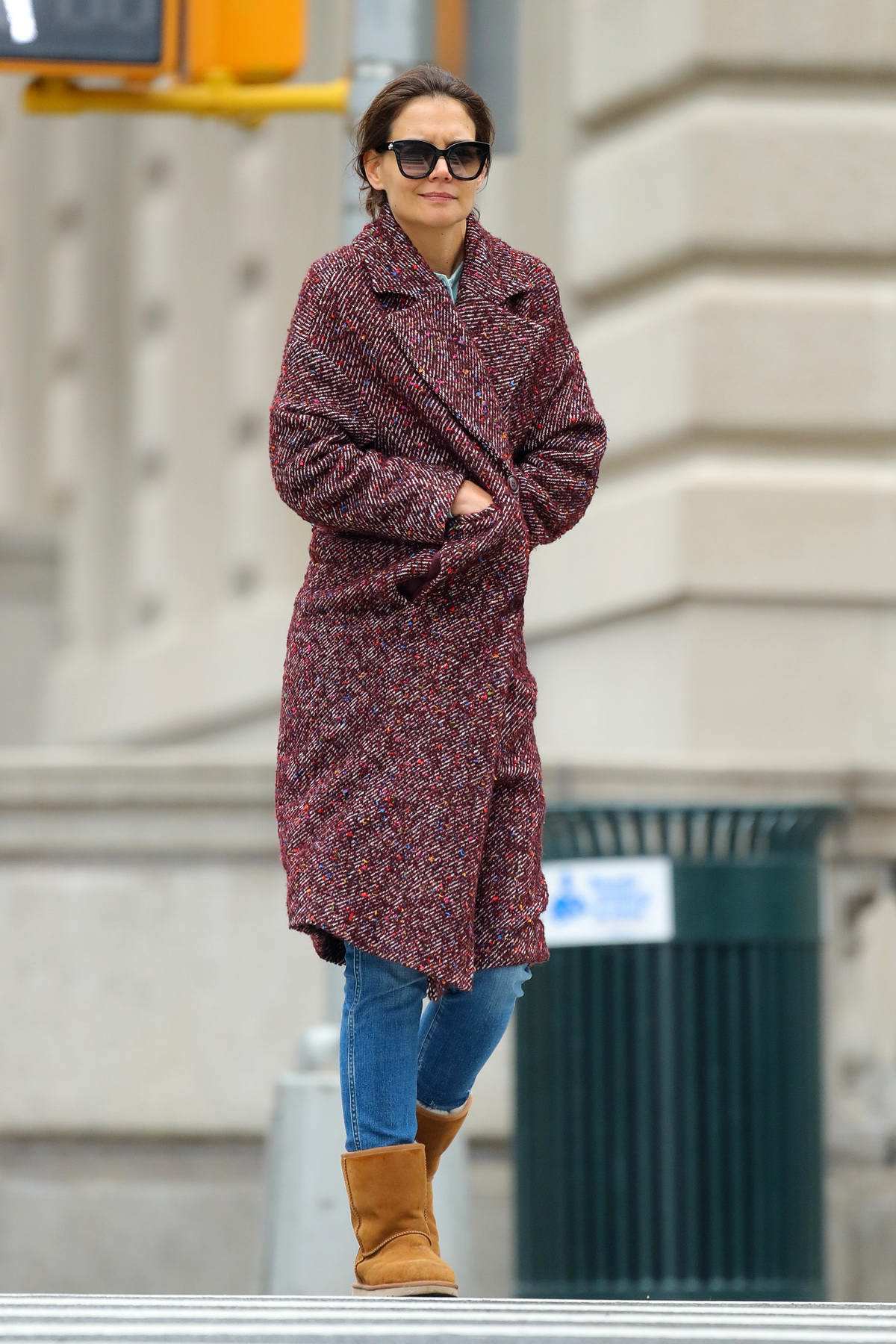 Katie Holmes wears a tweed coat and UGG boots as she steps out in New York City