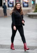 Kelly Brook is all smiles as she arrives at Global Radio Studios in London, UK