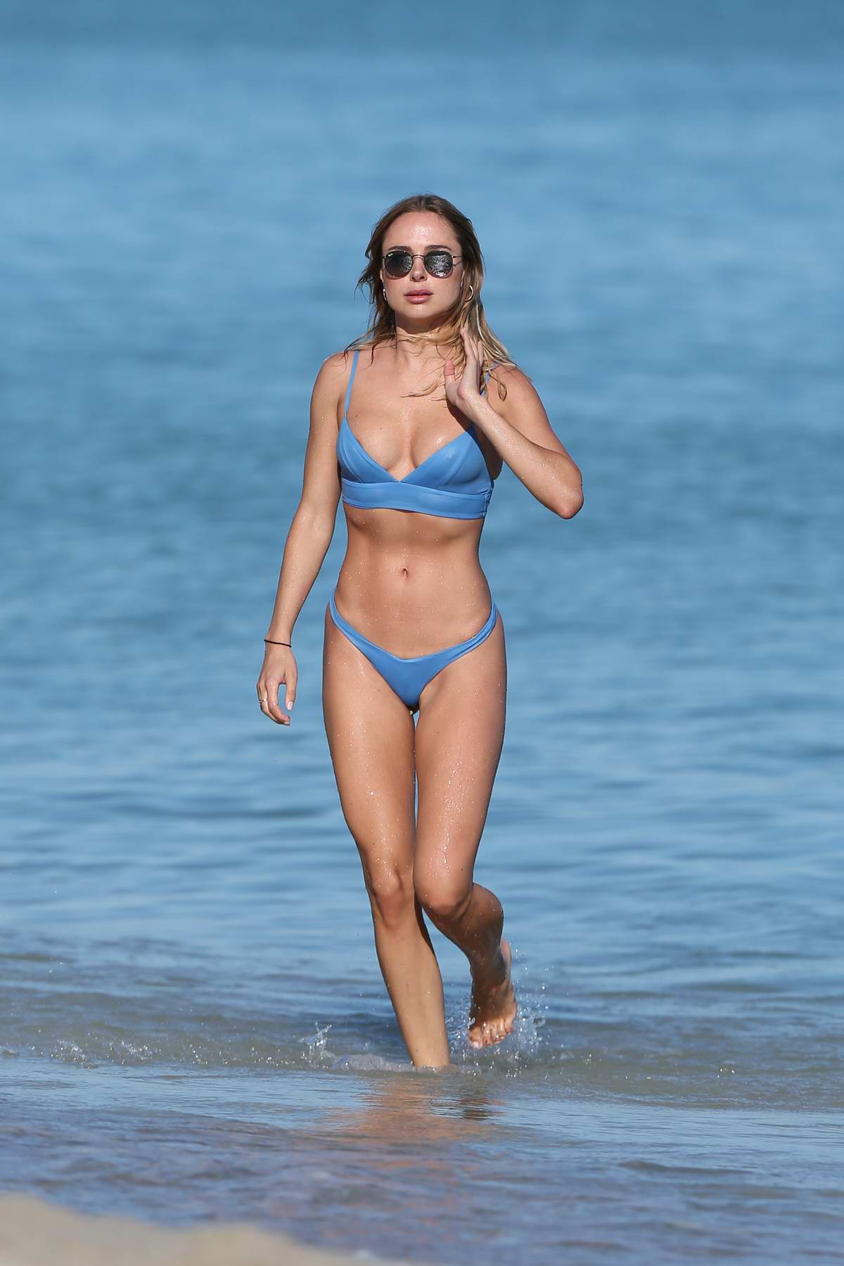 Kimberley Garner rocks a blue bikini from her own collection while enjoying at Miami Beach, Florida