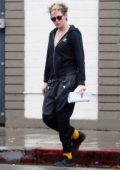 Kristen Stewart steps out in the rain to visit a hair salon in Los Angeles