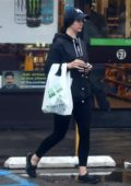Lana Del Rey buys a soda for a homeless man while shopping at 7-Eleven in West Hollywood, Los Angeles