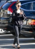 Lily Collins spotted leaving the gym wearing a black hoodie with matching black leggings in Los Angeles