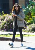Lily Collins wore a puffer jacket and leggings as she heads out after her workout in Los Angeles