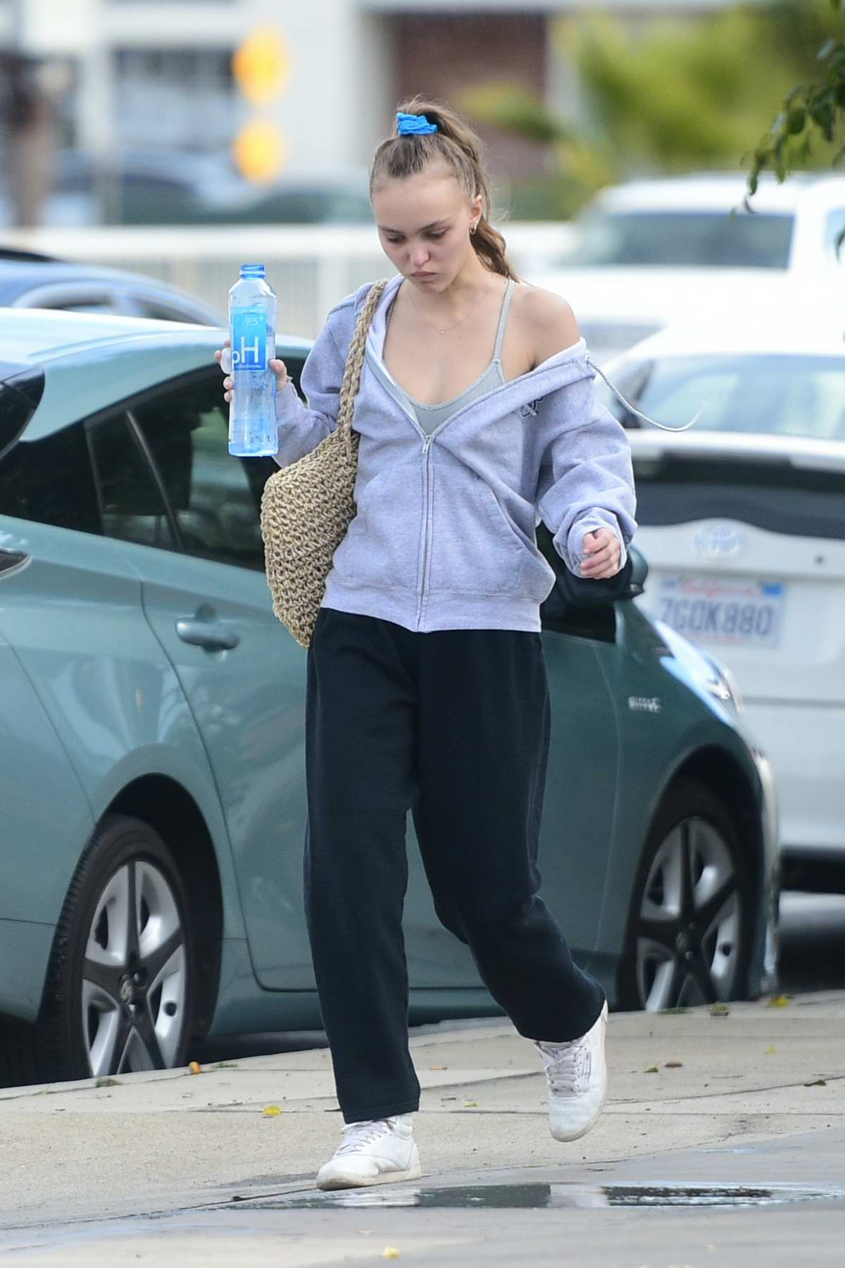 Lily-Rose Depp hydrates before her workout as she heads to the gym in Los Angeles