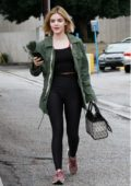Lucy Hale braves the rain with a green denim jacket as she heads for breakfast at Joan's on Third in Studio City, in Los Angeles