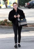 Lucy Hale bundles up in black jacket and leggings while out running errands in Studio City, Los Angeles