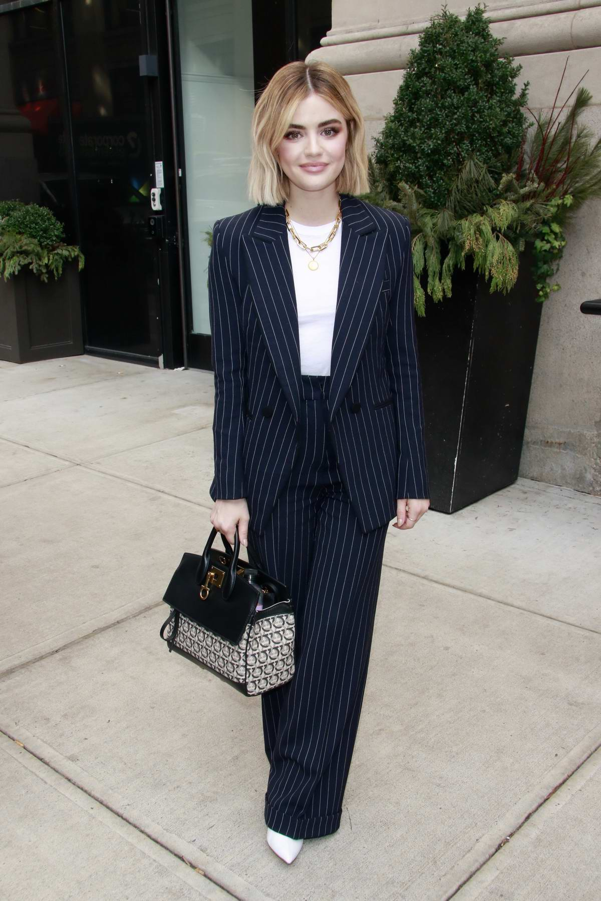 Lucy Hale wears a blue pinstripe suit while visiting BuzzFeed Studios in New York City