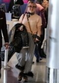 Maisie Williams sports a funky outfit as she departs on a flight in Los Angeles
