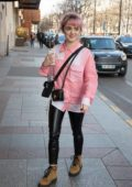 Maisie Williams wears a pink shirt to match her pink hair while out in Paris, France